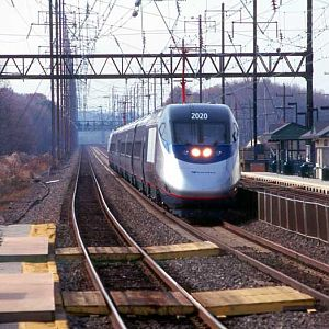 The first Acela heads east.