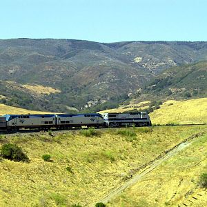 Coast Starlight rounds horseshoe curve at Cuesta Pass, California