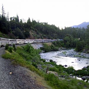 Coast Starlight rounding a river curve in Northern California