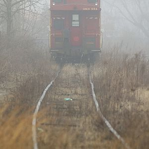 Caboose in the fog.