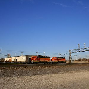BNSF new logoed GP38-2's 2020 and 2030 at Eola Yard