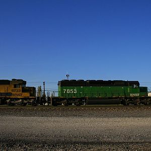 BN 7853 and Santa Fe 6733 at Aurora