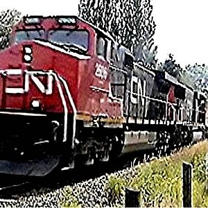 C N 2606 and 5744 at speed westbound at Fort Langley on a container train